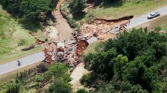 Road washed out natural disaster aerial - stock footage