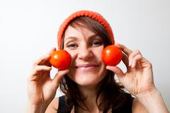 Young woman with tomato cheeks Stock Photos