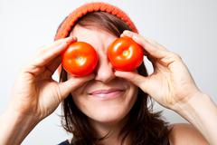 young woman with tomato eyes - stock photo