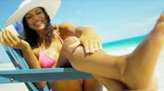 Hispanic Girl in Bikini Relaxing Paradise Beach Applying Sun Cream Stock Footage