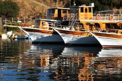 three boats in harbor - stock photo