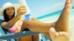 Latin American Girl Using Sunscreen Luxury Vacation Stock Footage