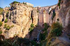 new bridge and falls in ronda white village. andalusia, spain. - stock photo