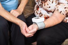senior blood pressure detail - stock photo