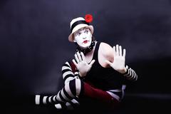 Theatrical mime in white hat Stock Photos