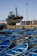 View of the seaport with blue fisher boats - stock photo