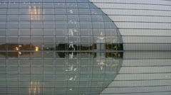 BeiJing China National Grand Theatre in reflection in lake water. Stock Footage
