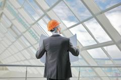 The engineer-builder watching, control process - stock photo