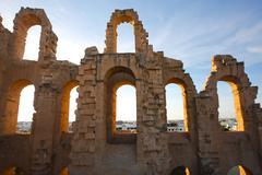 El Djem Amphitheatre arches with sunset Stock Photos