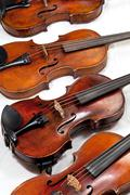 several used fiddles - stock photo