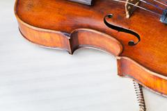 Violin bout with f-hole on music book Stock Photos