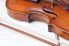violin bout and bow on music book - stock photo