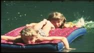 Vintage 8 mm film: Children swimming in lake Stock Footage