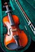 Violin in green velvet box Stock Photos