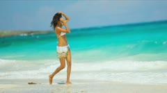 Hispanic Girl Splashing Ocean Shallows Tropical Beach Stock Footage