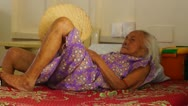 Old woman lying in bed Stock Footage