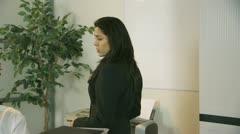 Demanding boss walks in on her employee Stock Footage