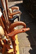 a collection of wooden walkingsticks - stock photo