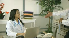 Doctor walks in and greets another doctor Stock Footage