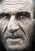 Closeup portrait of old man, wrinkled elderly skin, face Stock Photos