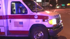 Ambulance driving off Stock Footage