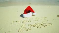 Seasonal Greeting Sand Beside Santa Hat Stock Footage
