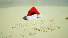 Seasonal Greeting Sand Beside Santa Hat Stock Footage