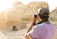 A tourist taking a photo of old archeological ruins Stock Photos