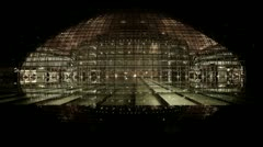 BeiJing China National Grand Theatre in reflection in lake water at night. Stock Footage