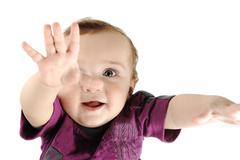 adorable desirable baby, closeup face, portrait, hands up wants something, gr - stock photo