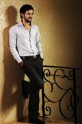 Stylish fashionable attractive young man, full lenght photo Stock Photos
