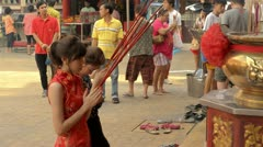Stock Video Footage of Thai-Chinese Women Praying on the Eve of Chinese New Year
