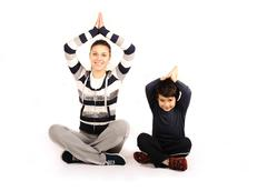 family - young woman and kid - doing sport, fitness exercises - stock photo