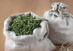 Dried herbs in linen bags Stock Photos