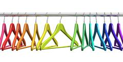 Rainbow coat hangers on clothes rail Stock Illustration