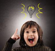 exellent idea, kid with illustrated bulb above his head - stock photo