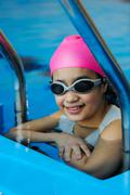 Girl in protective goggles leaves pool Stock Photos