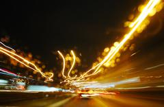 modern urban city with freeway traffic at night - stock photo