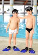 activities at the pool, children swimming and playing in water, happiness and - stock photo