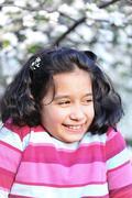 portrait of beautiful schoolgirl in spring - stock photo