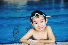 Activities on the pool, children swimming and playing in water, happiness and Stock Photos