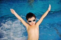 activities on the pool, children swimming and playing in water, happiness and - stock photo