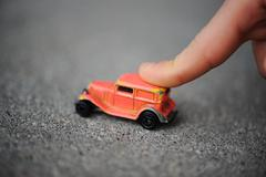 innocence, childhood concept - playing with toy car - stock photo
