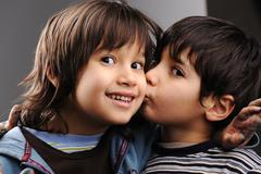 two brothers, kiss and love - stock photo
