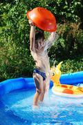 children activities on swiming poo - stock photo
