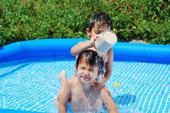 children activities on swiming pool - stock photo