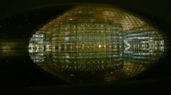 BeiJing China National Grand Theatre in reflection in lake water at evening. Stock Footage