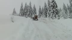 Bulldozer moving on snowy road, slow motion Stock Footage