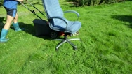 Stock Video Footage of concept man short rubber boot lawn cutter office boss chair