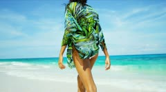 Hispanic Girl Walking Beside Ocean Shallows Tropical Beach Stock Footage